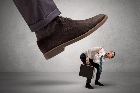 Employee afraid of the big boss foot Stock Photo
