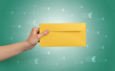 Hand holding envelope with symbols around Reklamní fotografie - 99462907