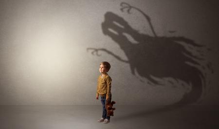 Scary ghost shadow behind kid