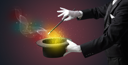 Illusionist hand making trick with wand