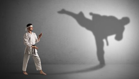 Karate man confronting with his own shadow