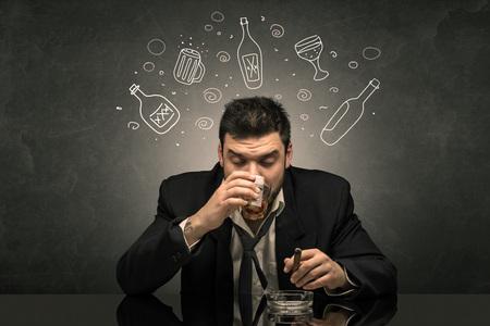 Drunk man with doodle alcohol bottles concept 版權商用圖片