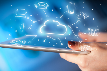 Hand working with cloud technology system and office symbol concept  Archivio Fotografico