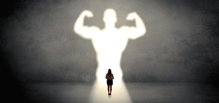 Woman standing and dreaming about a strong superhero