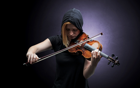 Violinst playing on instrument with empathy Stock Photo