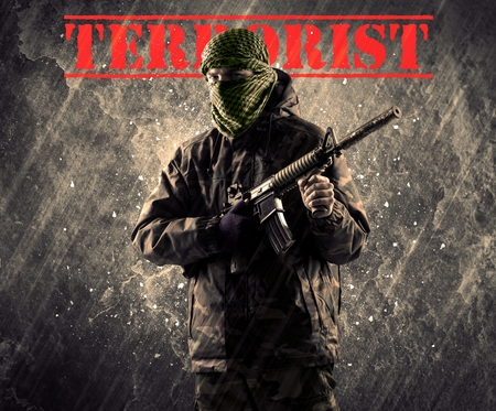 Dangerous masked and armed man with terrorist sign on grungy background