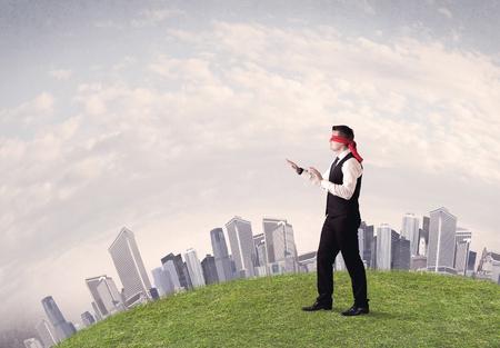Blindfolded businessman concept