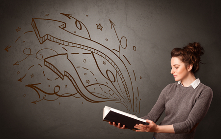 Young lady holding book with arrows Stock Photo