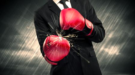 Boxing gloves clashing Фото со стока