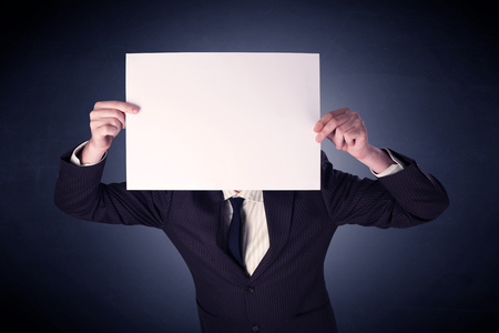 Businessman holding blank paper