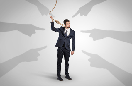 Businessman trying to suicide with pointing hands concept