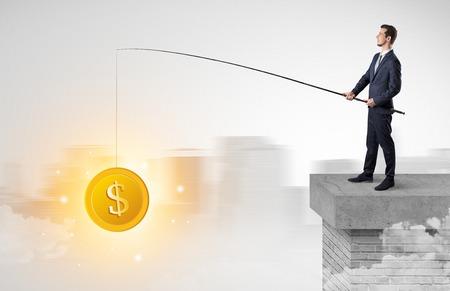 Businessman fishing coins concept