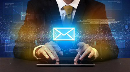 Businessman typing and mailing icon above