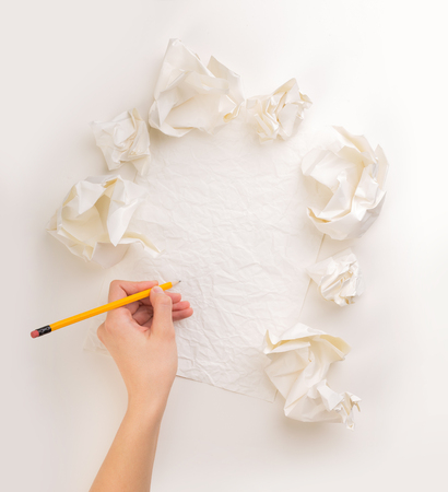 Writing hand in crumpled paper Stock Photo