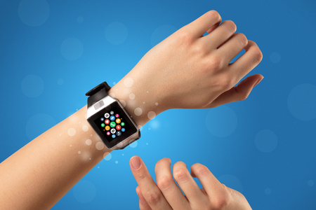 Naked female hand with smartwatch and with application icons on it Stockfoto
