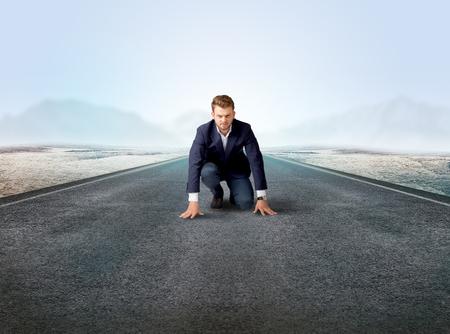 Businessman kneeling in ready position