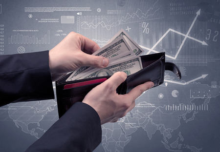 Businessman hand takes out dollar from wallet Reklamní fotografie