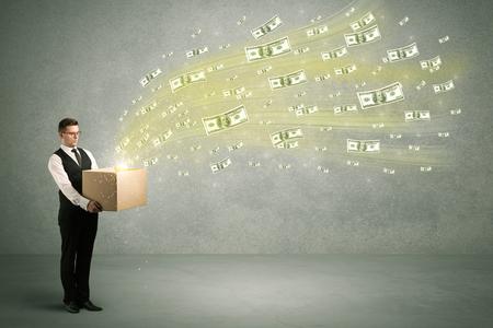 Money flying from box concept Foto de archivo
