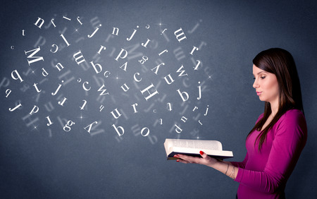 Young lady holding book with letters