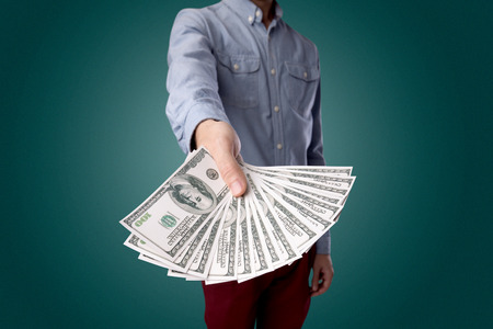 Businessman holding money 写真素材