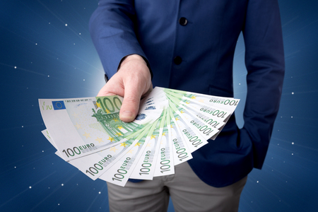 Businessman holding money Standard-Bild