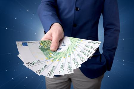 Businessman holding money Foto de archivo