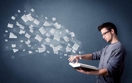 Young man holding book Banco de Imagens