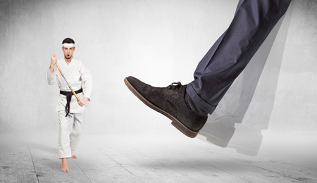 Big foot trample karate trainer concept Stock Photo