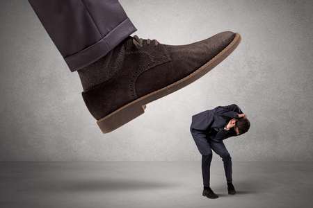 Employee afraid of the big boss foot Stock Photo