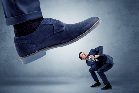 Cruel boss tramping his employee Stock Photo - 102694892