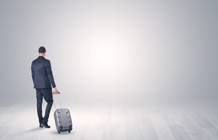 Business with luggage in a boundless space Foto de archivo