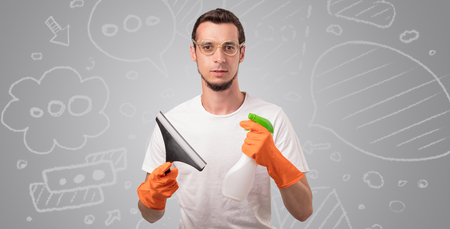 Male housekeeper with grey doodled wallpaper