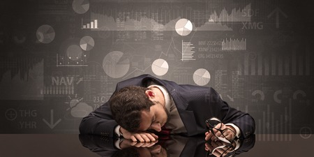 Businessman sleeping with charts, graphs and reports concept Reklamní fotografie