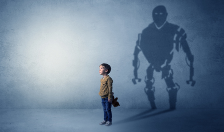 Robotman shadow of a cute little boy Banco de Imagens