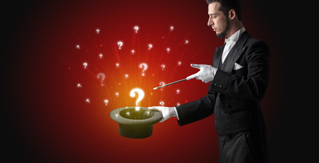 Magician conjure question signs from a cylinder