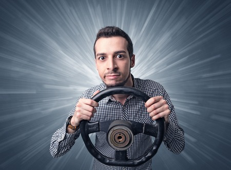 Man holding steering wheel Stock Photo
