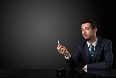 Businessman holding cigarette.