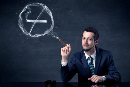 Businessman smoking cigarette. Archivio Fotografico
