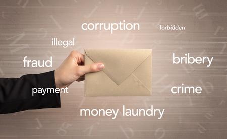 Hand holding envelope with words around Foto de archivo