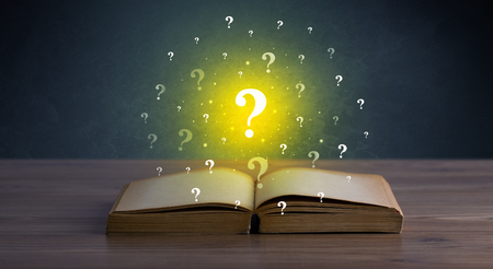 Question marks over book Stock Photo