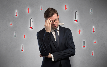 Businessman with thermometer and fever concept Stock Photo