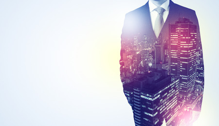 Businessman standing with night city graphic