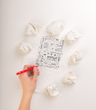 Writing hand in crumpled paper Banque d'images
