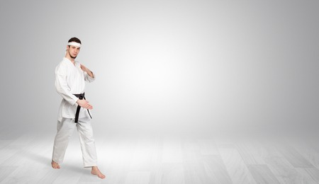 Karate trainer fighting in an empty space