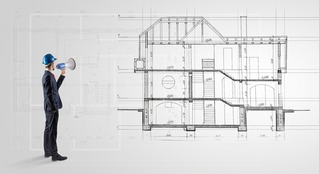 Architect looking to a house plan Stock Photo