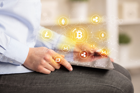 Business woman using tablet with bitcoin link network concept