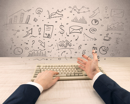 Elegant businessman hand typing with doodle report and chart concept Stock Photo