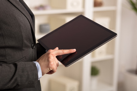 Business woman using tablet in a cozy environment Stock Photo