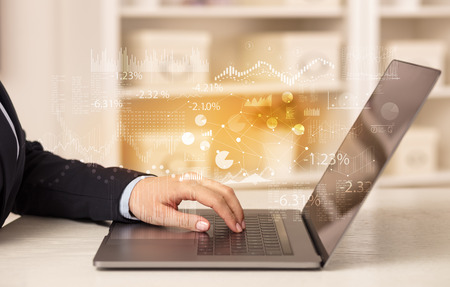 Business woman working on laptop with financial report concept Stock Photo