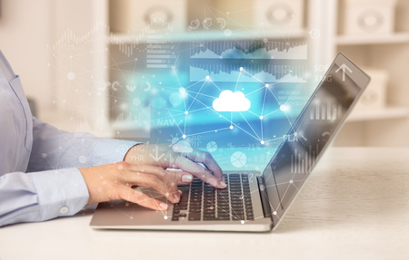 Business woman working on laptop with cloud technology concept Stock Photo